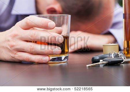 Alcoholic Sleeping On The Table