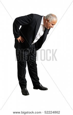 senior businessman examining something on the floor. isolated on white background