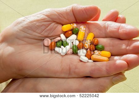 Cocktail Of Pills And Tablets In An Elderly Hand