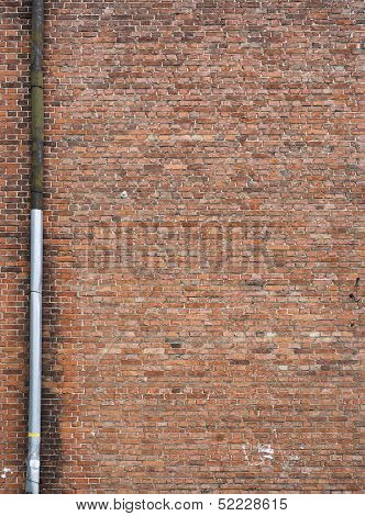 Ancient red brick wall texture with tube