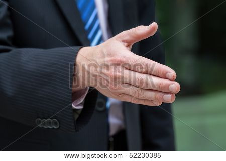 Businessman Hand Just Before A Handshake