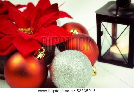 Christmas decoration with poinsettia and candle