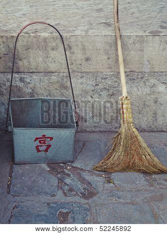 Old Broom And Dust Pan On Beijing Street