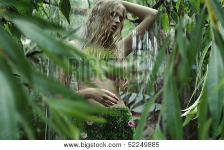 Blonde beauty in tropical forest