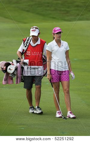 KUALA LUMPUR - OCTOBER 13: Paula Creamer of USA discusses with her caddy on the next play at the KLGCC course on the final day of the Sime Darby LPGA on October 13, 2013 in Kuala Lumpur, Malaysia.
