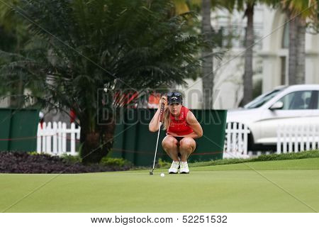 KUALA LUMPUR - OCTOBER 13: Sandra Gal of Germany lines her putt at the 2nd hole green of the KLGCC course on the final day of the Sime Darby LPGA on October 13, 2013 in Kuala Lumpur, Malaysia.