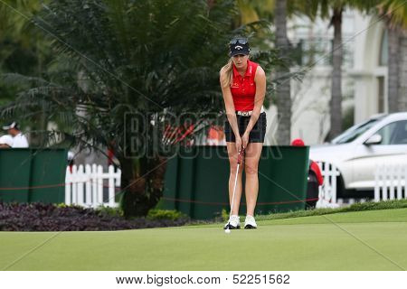 KUALA LUMPUR - OCTOBER 13: Sandra Gal of Germany putts at the 2nd hole of the KLGCC course on the final day of the Sime Darby LPGA on October 13, 2013 in Kuala Lumpur, Malaysia.