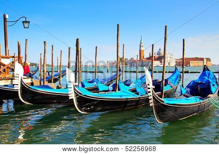 Gondolas near Saint Mark square and San Giorgio di Maggiore church in the background - Venice, Italy