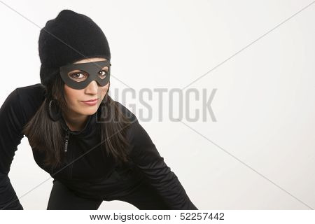 Masked Woman Sneaking Lurking Around Looking For Something To Steal