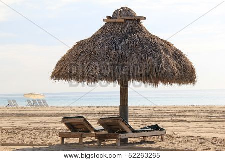 Lounge chairs and tiki huts
