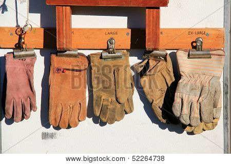 Well worn leather work gloves