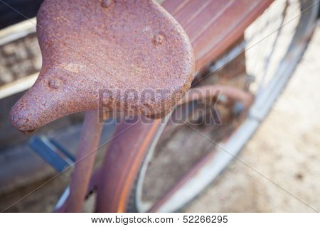 Abstract of Old Rusty Antique Bicycle Seat in a Rustic Outdoor Setting.