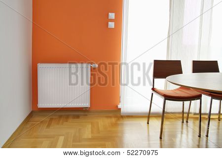 Heating Radiator on the Orange Wall