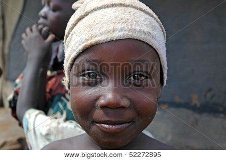 African Boy Smiles With Hat