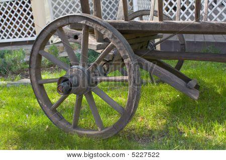 Wheel Of An Ancient Wooden Cart.