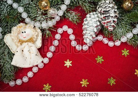 christmas decoration and angel toy on red textile