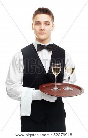 Young Waiter With Glasses Of White Wine