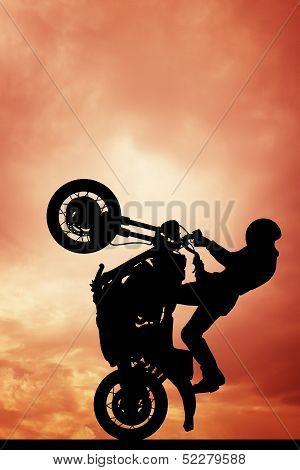 Stuntman Motorcyclist At Sunset