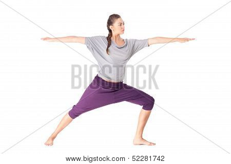 Young Woman Doing Yoga Exercise Warrior Pose