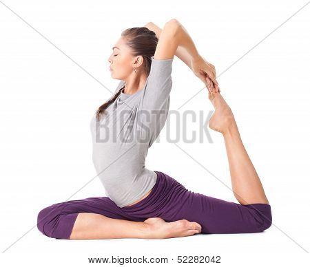 Young Woman Doing Yoga Asana Eka Pada Rajakapotasana (one Legged King Pigeon)