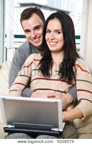 Happy Couple Browsing Internet At Home