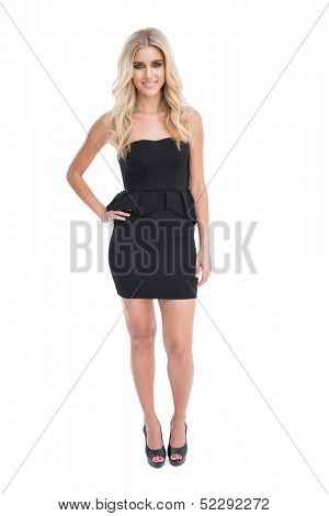 Gorgeous blonde girl in classy black dress posing on white background