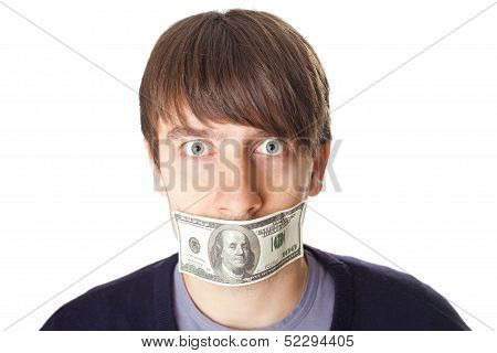 Portrait Of Young Man With A 100 Dollar Banknote On His Mouth Isolated On White Background