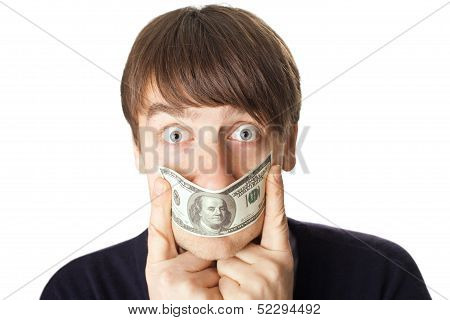 Portrait Of Young Man Covering His Mouth A 100 Dollar Banknote Isolated On White Background