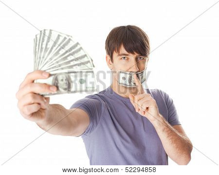 Young Man Holding A Dollar Bills  His Mouth Sealed By Hundred Dollar Bills Isolated On White