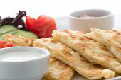 foto of flat-bread  - Traditional Turkish flat bread called gozleme isolated on white background - JPG