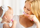 stock photo of toothbrush  - happy family and health - JPG