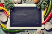 picture of slating  - Slate board with fresh vegetables spice and herbs on wooden background - JPG