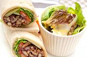 picture of sandwich wrap  - kafta shawarma chicken pita wrap roll sandwich traditional arab mid east food - JPG
