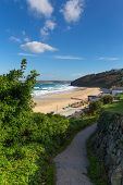 foto of st ives  - South West Coast Path Carbis Bay Cornwall England near St Ives with a sandy beach and blue sky on a beautiful sunny day - JPG