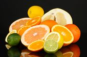 pic of pamelo  - Lots ripe citrus isolated on black - JPG