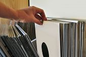 stock photo of analogy  - Browsing through vinyl records collection - JPG