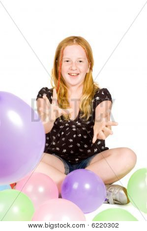Young Girl Playing With Balloons