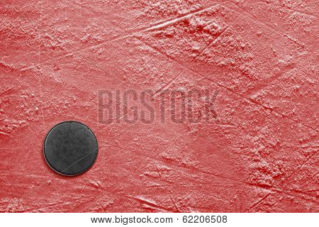 Hockey Puck On Ice Red