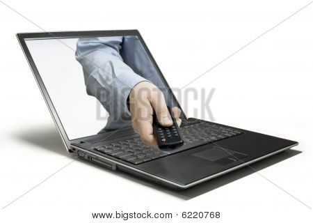 Hand reaches remote out a laptop