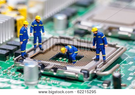 Group Of Construction Workers Repairing Cpu