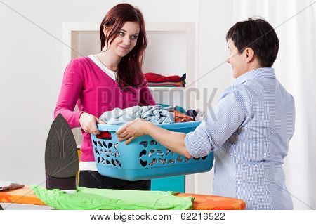 Mother And Daughter Sharing Chores