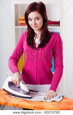 Smiling Woman During Ironing