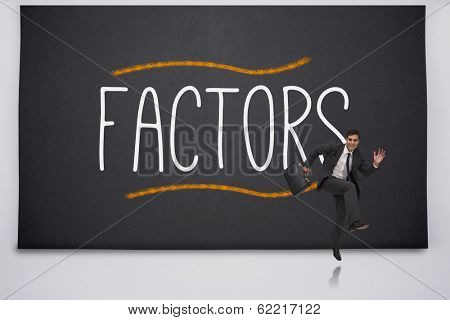 Happy businessman jumping against the word factors