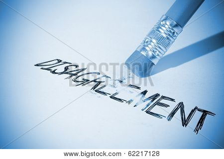 Pencil erasing the word disagreement on paper
