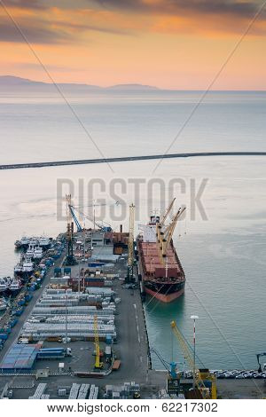 Harbor pier with cargo ship loading