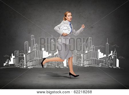 business, time and education concept - stressed young businesswoman with clock running