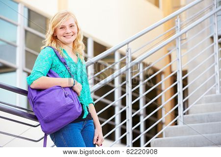 Female High School Student Standing Outside Building