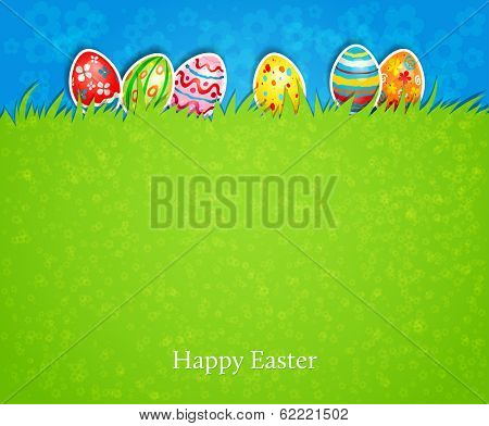 Holiday easter background. The colored eggs on the green grass