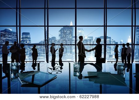 Silhouette Business People in Office With City Skyline