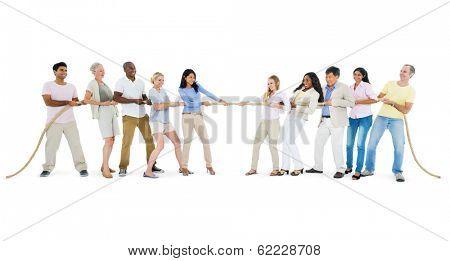 Large Group of People Playing Tug of War
